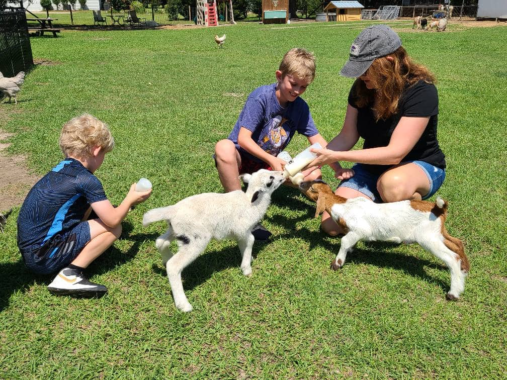 Childrens birthday party near me. A photo of a mom and her kids with our animals.