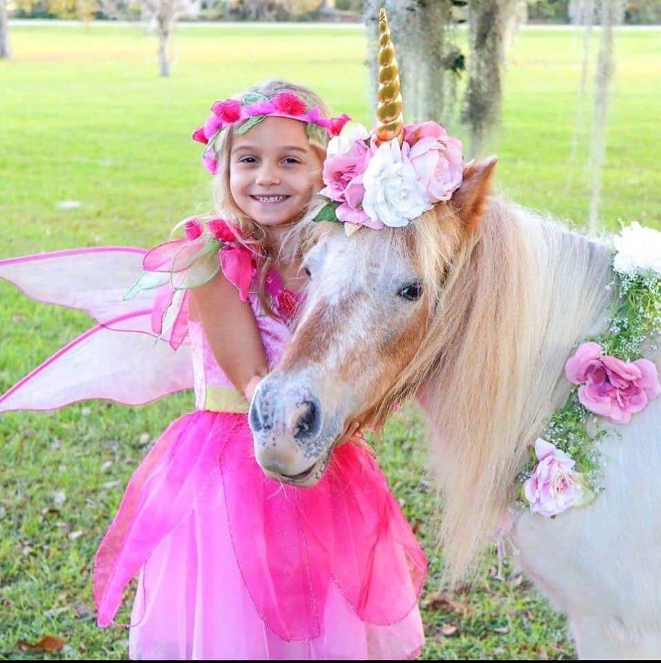 Unicorn Birthday Party. A photo of a little girl with a unicorn.