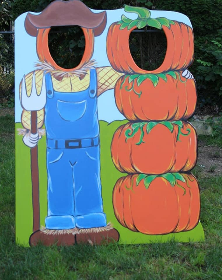 Fall Festival Valdosta. A photo of pumpkins with the center cut out to put your head through for a photo.
